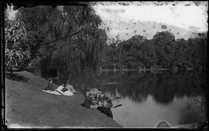 Glass Negative of people by a lakeside